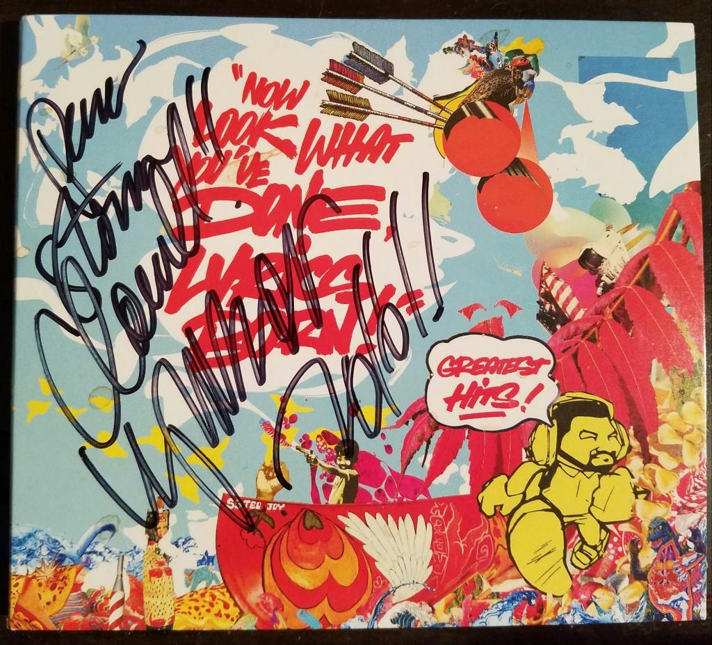 Autographed Lyrics Born CD