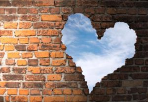 heart through brick wall